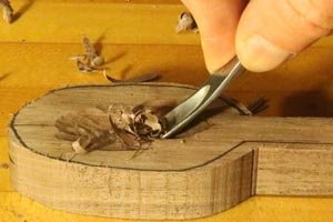 Hand carving the bowl on a wooden spoon.