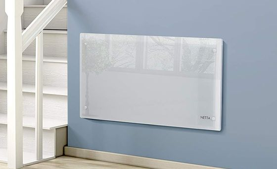 Wide Glass Panel Heater On Painted Wall